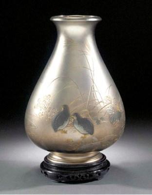 A shakudo silver pear-shaped v