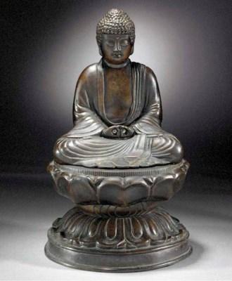 A bronze model of Buddha 18th/