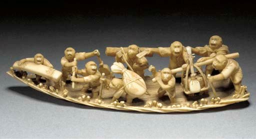 An ivory okimono of a group of