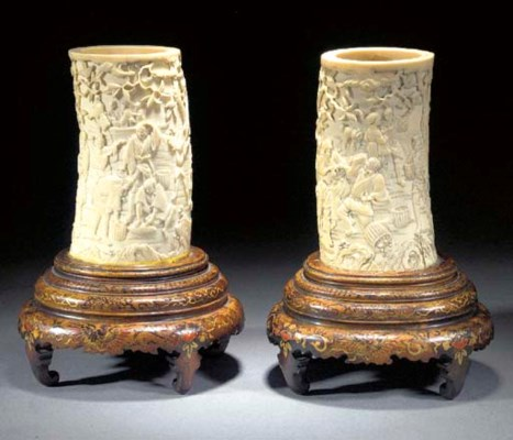 A pair of tusk vases 19th cent
