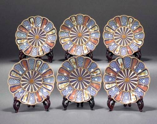 Six Imari moulded kiku form bo