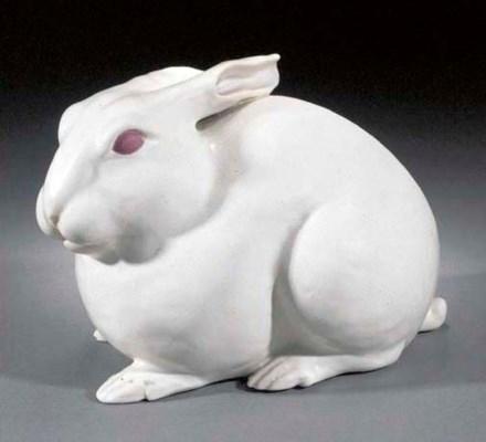 A white glazed model of a rabb