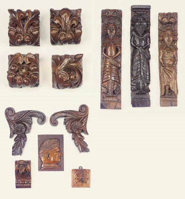 A collection of carved oak pan