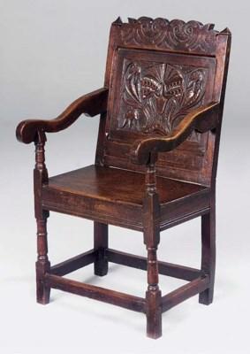 An oak panel back armchair, No