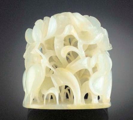 A pale celadon jade carved fin