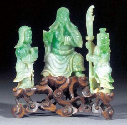 A jadeite group of three figur
