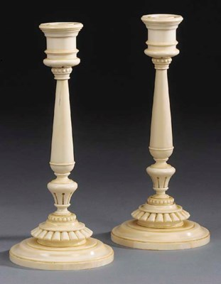A pair of  turned ivory candle