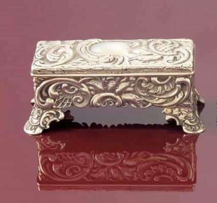 A silver triple stamp case