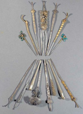 A group of thirteen silver and