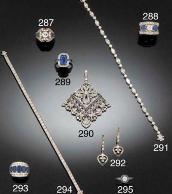 A MARQUISE DIAMOND AND DIAMOND