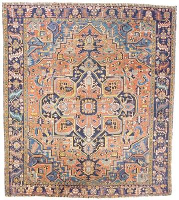 An antique Heriz carpet