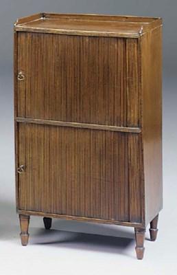 A mahogany tambour front bedsi