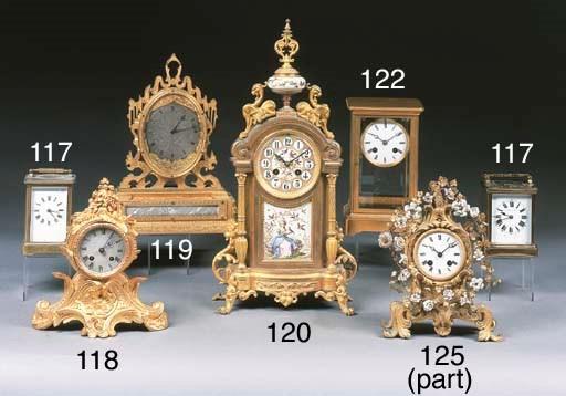 A gilt brass four glass mantle