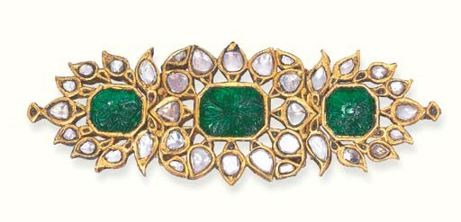 A CARVED EMERALD AND DIAMOND A