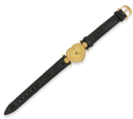 A LADY'S 18K GOLD AND YELLOW D