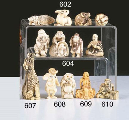 * A JAPANESE IVORY NETSUKE OF