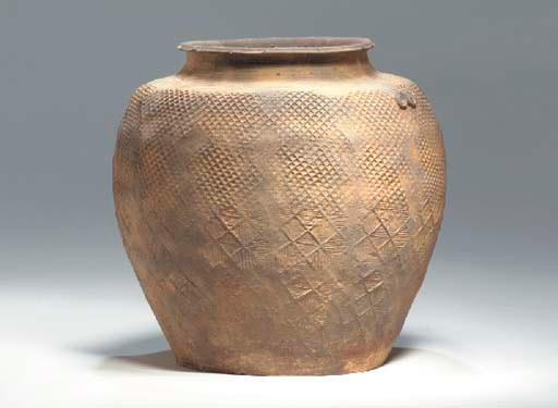 An Impressed Grey Pottery Jar,