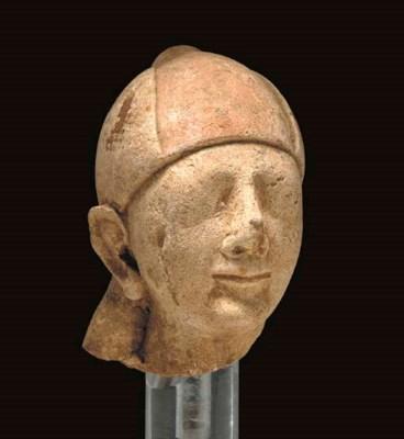 A CYPRIOT LIMESTONE HEAD