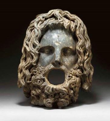 A ROMAN BLACK MARBLE HEAD OF S