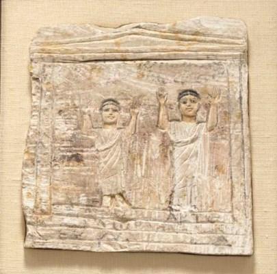 AN EGYPTIAN LIMESTONE KOM ABU