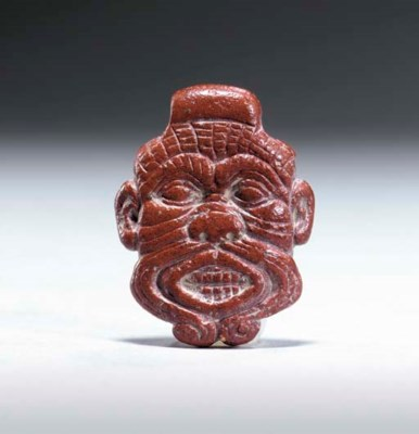 A WESTERN ASIATIC RED STEATITE