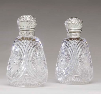 A PAIR OF CUT GLASS DECANTERS