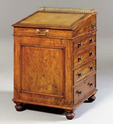 AN EARLY VICTORIAN WALNUT DAVE