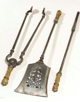A GROUP OF BRASS FIRE UTENSILS