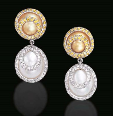 A PAIR OF WHITE AND GOLD CULTU