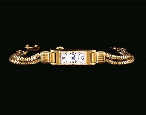 Cartier. A lady's 18K gold rec