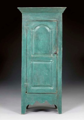 A BLUE-PAINTED PANELED DOOR CU
