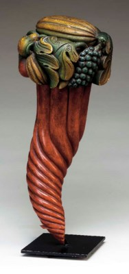A CARVED AND POLYCHROME PAINTE