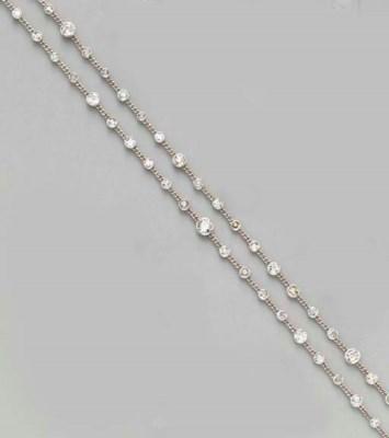A DIAMOND AND PLATINUM LONGCHA
