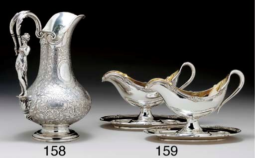 A PAIR OF RUSSIAN SILVER SAUCE