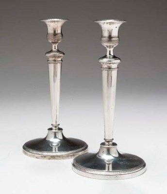 A PAIR OF ITALIAN SILVER CANDL