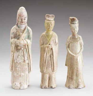 A GROUP OF FOUR BUFF POTTERY F