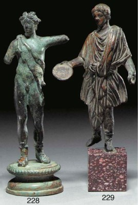 A ROMAN BRONZE FIGURE OF A LAR