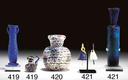 AN ISLAMIC GLASS BOTTLE