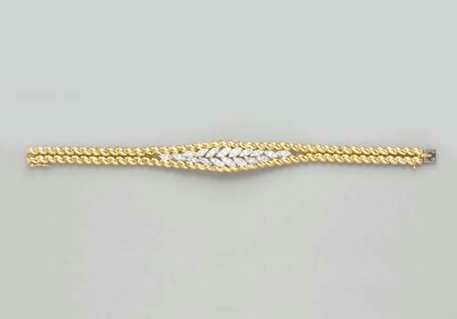 A DIAMOND AND GOLD BRACELET WA