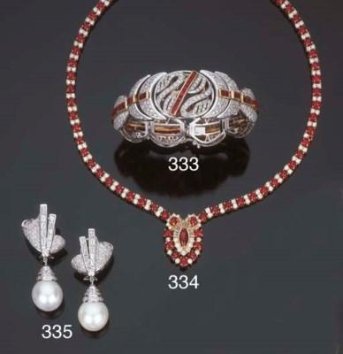 Paio di orecchini con perla au