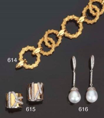 Coppia di anelli a fascia in o