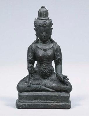 an east javanese bronze figure