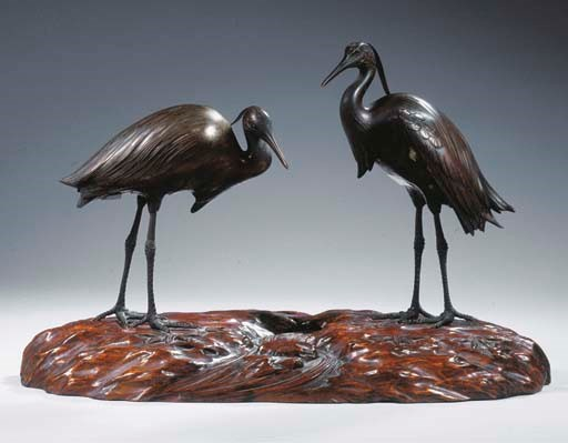 A pair of silvered-bronze hero