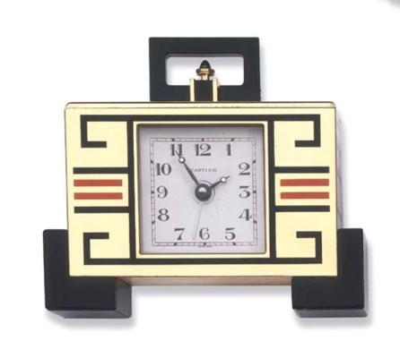 AN ENAMEL DESK CLOCK, BY CARTI