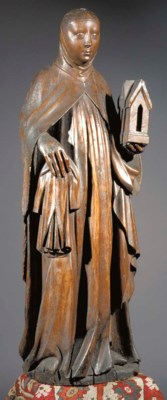 A carved wood figure of Barbar