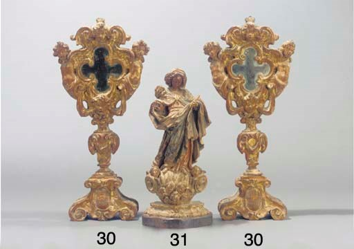 (2) A pair of carved giltwood