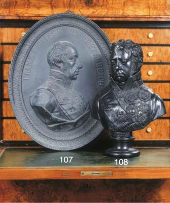 A cast iron portret relief of