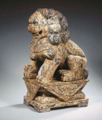 A Chinese carved wood lion