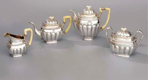 A four-piece parcel-gilt tea a