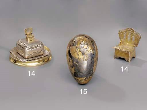 A silver-gilt and niello egg